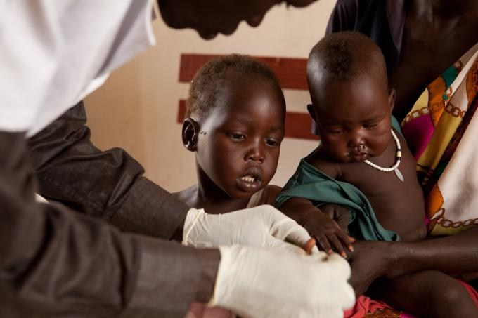 3-year-old Pagak is tested for malaria at a health clinic supported by Save the Children in Pagak, Upper Nile state, South Sudan. (Colin Crowley/Save the Children)